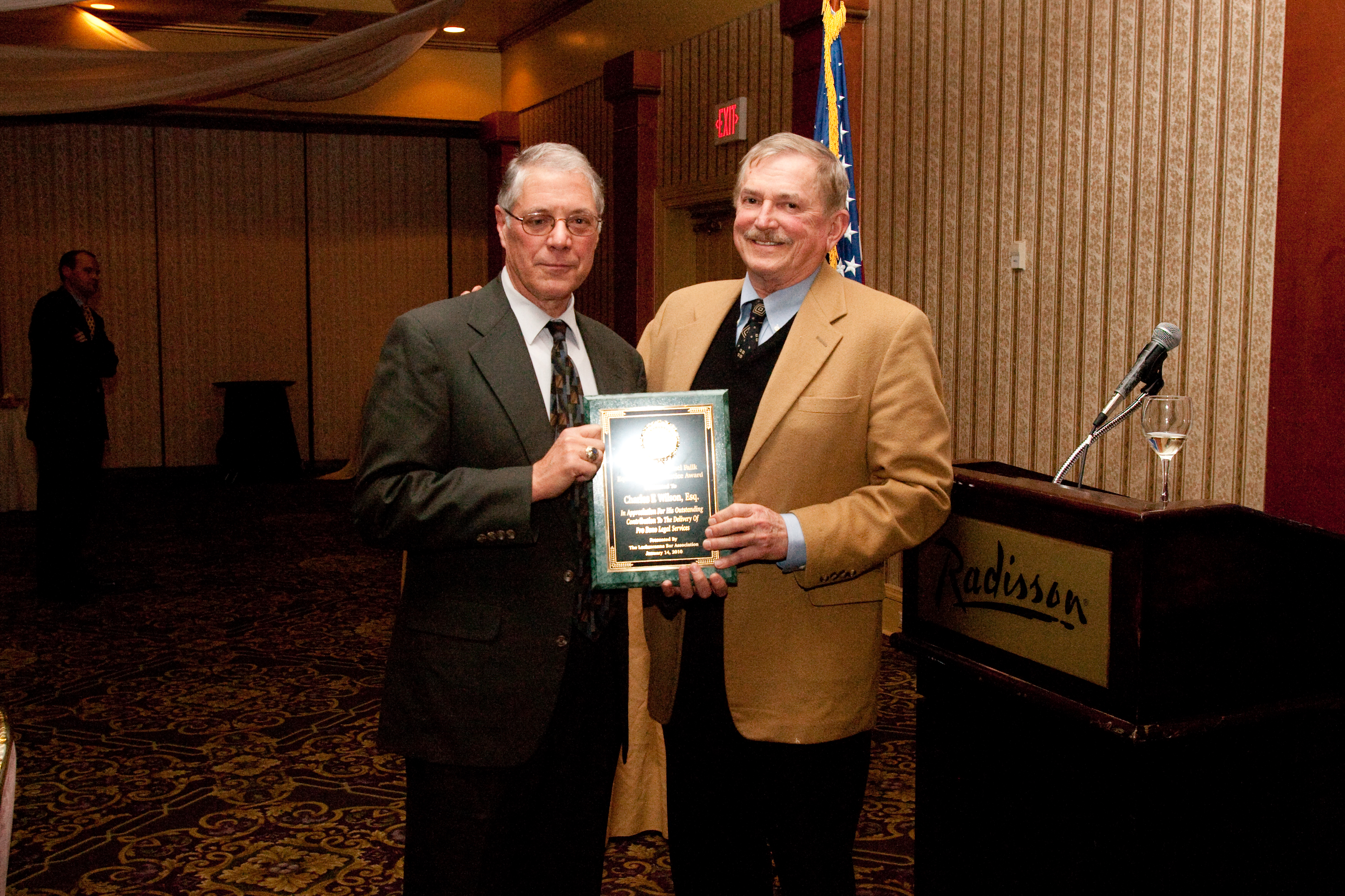 Charles F. Wilson, Esq. receiving the Samuel Fallk award from Hon. Chester T. Harhut, president judge of the Lackawanna County Court of Common Pleas